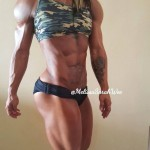 female muscle tattoo